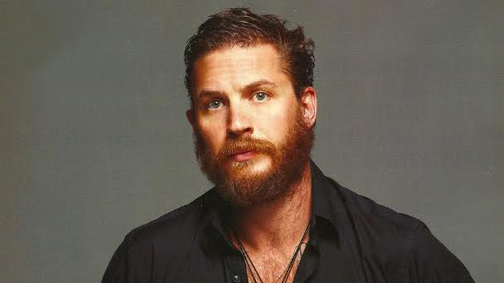 Tom hardy with a sporting ginger beard