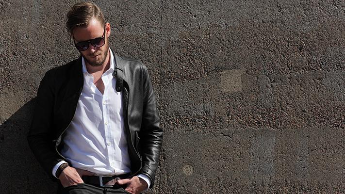 black leather jacket with dark denims