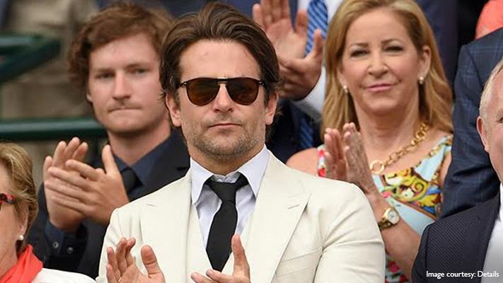 bradley cooper at wimbledon match in a beige suit
