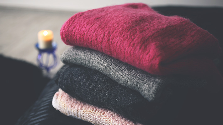 fold sweaters while storing