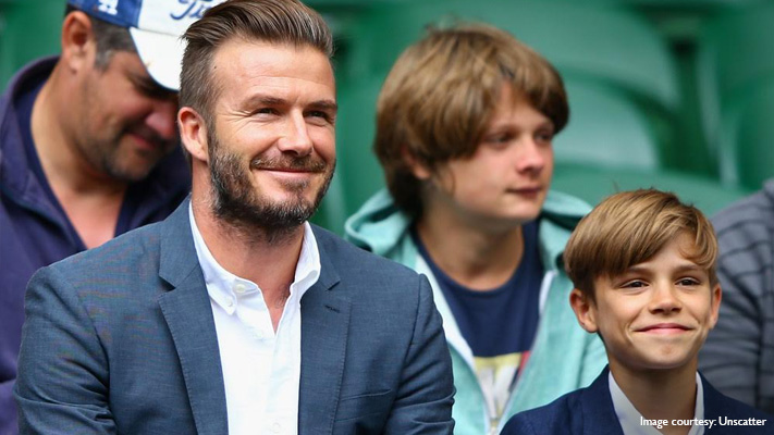 impeccably dressed david beckham at wimbledon stands