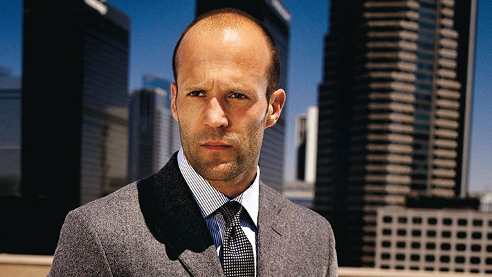 jason statham wearing black wollen vintage blazer