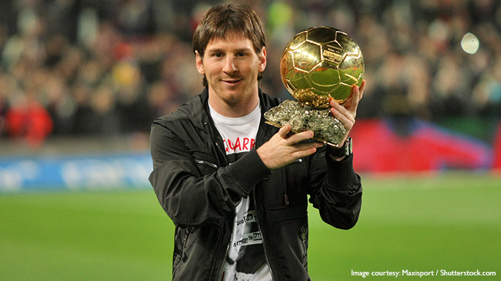 lionel messi holding ballon d or for 5th time