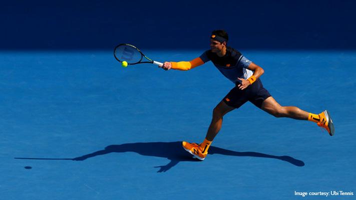 milos raonic sporting fluorescent colours australian open