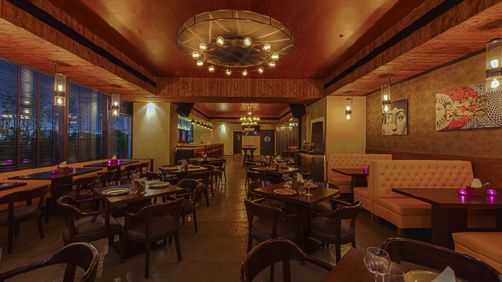 the good wife restaurant with brown lighting wood paneling