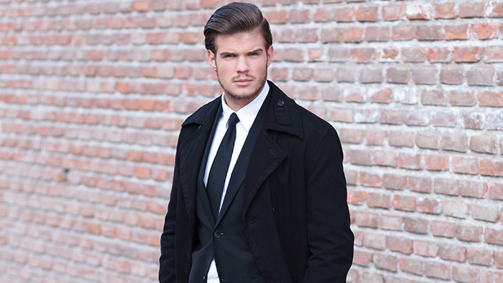 trench coat worn over suit works out stylish