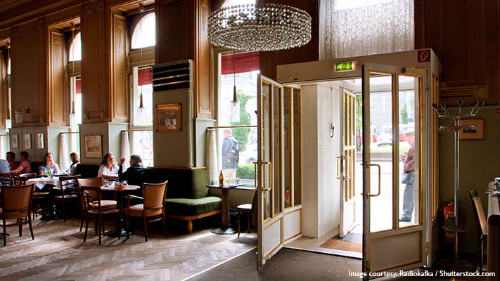 viennese coffee house with newspapers card games for relaxation