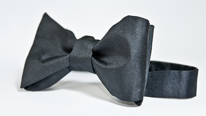 wearing a bow tie with tuxedo